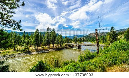 Trestle Bridge over the Nicola River as it flows along Highway 8 from the town of Merritt to the Fraser River at the town of Spences Bridge in British Columbia, Canada