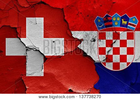 Flags Of Switzerland And Croatia Painted On Cracked Wall