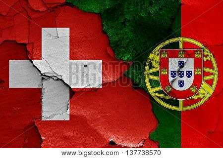 Flags Of Switzerland And Portugal Painted On Cracked Wall