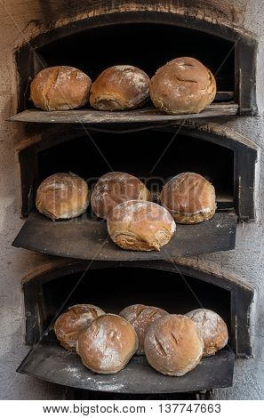 Freshly baked bread in a wood-fired stone oven