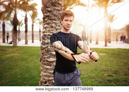 Muscular Man Training At The Park