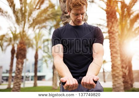 Sportsman Looking At His Muscles