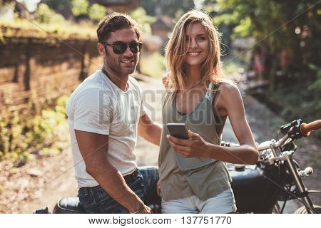 Happy Young Couple With Motorcycle
