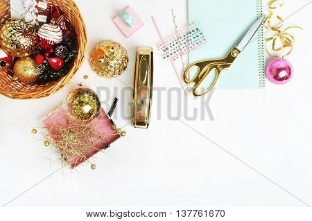 Flat lay. Mock-up product view table gold accessories. Xmas toys, stationery supplies. glamour style. Gold stapler. polka gold. Header website or Hero website. Workspace. Home office