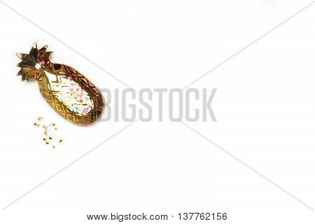 White mock up background flat lay. Gold pineapple. View up. Feminine scene workspace. Party background. Female