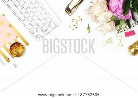 Flat lay. Flower on the table. Keyboard and stapler stationery supplies. Glamour style Table view. Business accessories. Mock-up background. Peonies