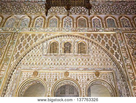 SEVILLE, SPAIN - September 12, 2015: The splendour of the mudejar civil architecture and caliphal art Alcazar of Seville on September 12, 2015 in Seville, Spain