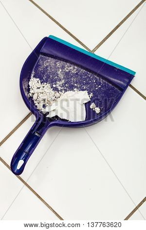 Scoop hygene chores housework tidying sweeping concept. Dust pan with garbage. Sweeping tool with dirt.