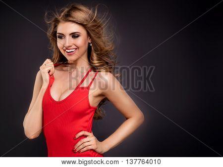 Blonde Sexy Girl Posing In Red, Studio Shot.