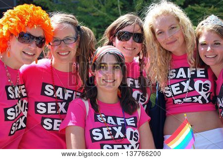 SEATTLE, WA__CIRCA : JUNE 28, 2009__Women wearing safe sex is sexy tee shirts at a Gay Pride celebration.