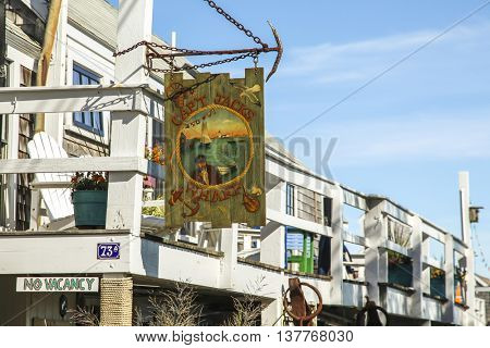 PROVINCETOWN-SEPTEMBER 14: Cap`t Jacks wharf sign in Provincetown, Cape Cod , Massachussets, USA on September  14, 2014.