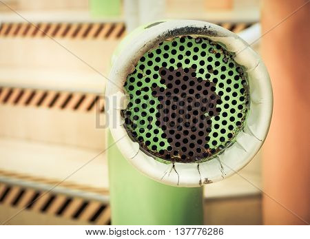 Voice communication with a green tube speaker, Selective focus and Close up image