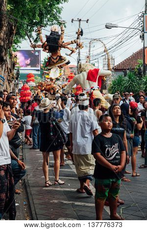 Visitors Watch And Take Photo Of The Ogoh-ogoh Statues At The Parade, Kuta, Bali