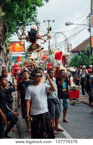 Visitors Take Photo Of The Ogoh-ogoh Statues At The Parade, Kuta, Bali
