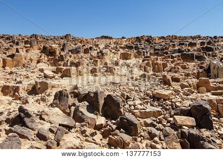 National geological park HaMakhtesh HaRamon - Ramon Crater is the Largest crater- geological erosion land form in Israel . Solidified igneous rocks . poster