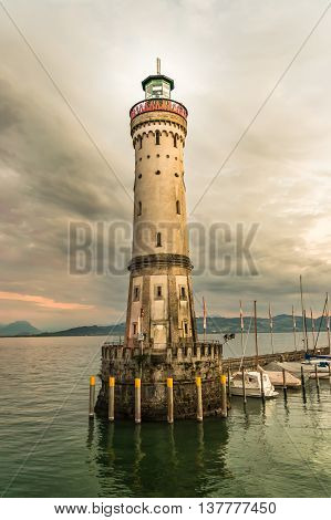 Lighthouse And Sunset In Harbor Of Lindau In Lake Constance