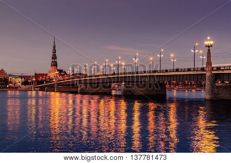 Riga, Latvia: Old Town of at night. The view from Daugava river