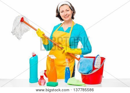 A Young Housewife With A Mop And Cleaning Agents Posing On A White Background