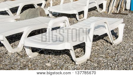 holiday beach deck chairs on the pebble