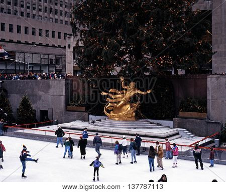 NEW YORK, USA - DECEMBER 9, 1994 - Ice rink and Prometheus statue in the Rockefeller Plaza at Christmas New York USA, December 9, 1994.