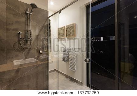 Modern Bathroom Shower Area With Glass Doors