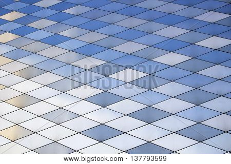Abstract architectural pattern. Metal texture background. Colored metal plates.