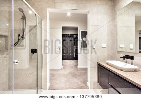 Entrance To A Laundry Room Through The Modern Washroom
