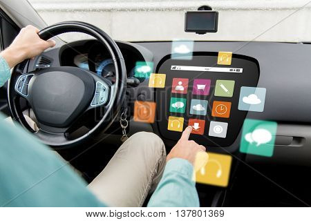 transport, modern technology, multimedia and people concept - close up of man driving car with menu icons on board computer screen