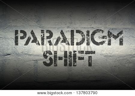paradigm shift stencil print on the grunge white brick wall