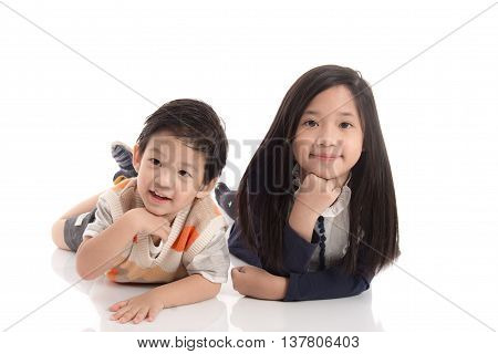 Close up asian child lying and smile on white background isolated