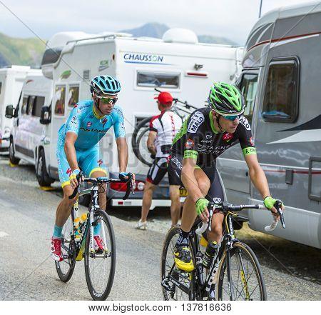 Col de la Croix de Fer France - 25 July 2015:The cyclists Anthony Delaplace of Bretagne-Seche Environnement Team and Lieuwe Westra of Astana Team climbing to the Col de la Croix de Fer in Alps during the stage 20 of Le Tour de France 2015.