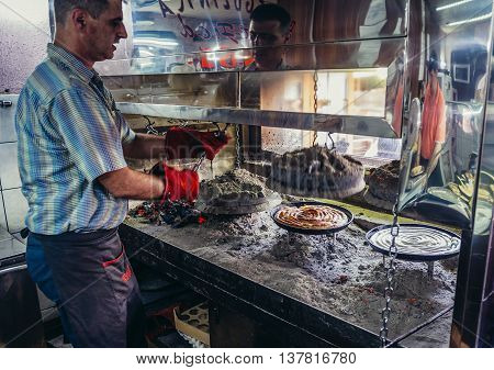 Sarajevo Bosnia and Herzegovina - August 23 2015. Man makes so called rolled burek in small restaurant in Sarajevo