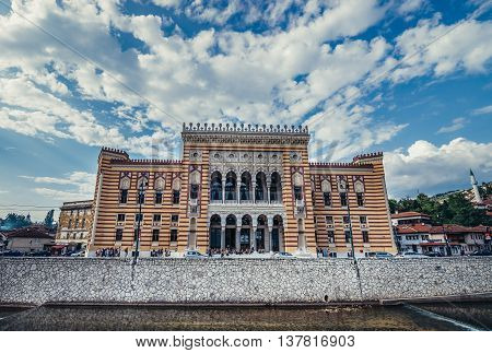 Sarajevo Bosnia and Herzegovina - August 23 2015. Sarajevo City Hall building commonly known as Vijecnica completed in 1896 lecated on the bank of Miljacka River
