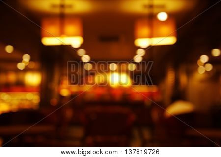blur light lamp in dark night cafe abstract
