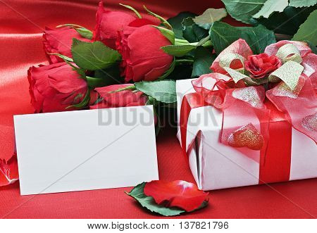 red roses and white card with a place for a congratulatory text