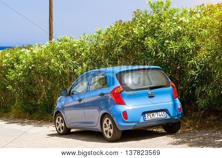 BALI, GREECE - APRIL 29, 2016: Rental car Kia Picanto are parked on sloping street about office leasing auto. Subcompact economical transportation. Resort village Bali, Rethymno, Crete, Greece