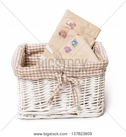 wicker basket with letters isolated on white background
