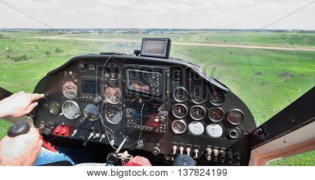 Light plane landing on the rough airstrip - view from the pilot's seat
