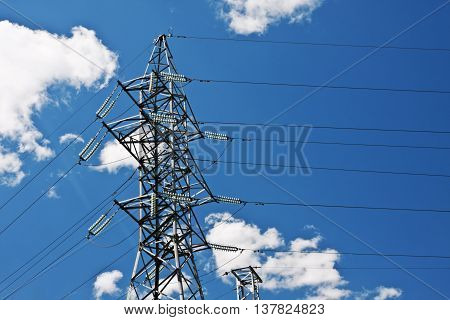 Electric high voltage post with sky background poster