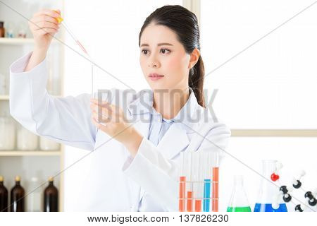 Careful, Meticulous Work Of Asian Female Scientist