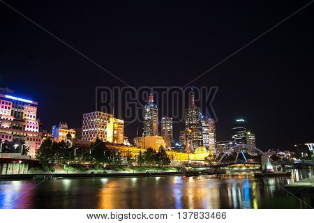 Nightshot of Melbourne with reflections in the river