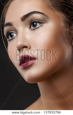 Beautiful Face Of Young Woman With Clean Fresh Skin Close Up Isolated On Black. Beauty Portrait. Bea