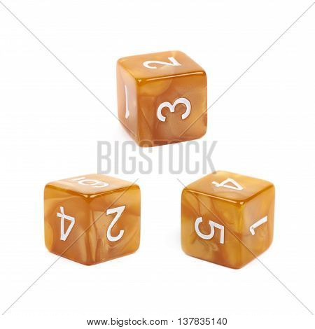 Roleplaying orange polyhedral gaming plastic dice cube isolated over the white background, set of three different foreshortenings