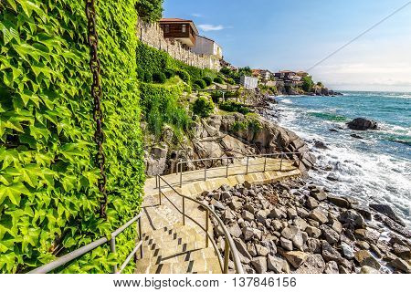 SOZOPOL - AUGUST 9: Old City embankment on August 9 2015 in Sozopol Bulgaria.ancient european city Sozopol on a rocky shore near sea in summer. piere and steps to sea shore