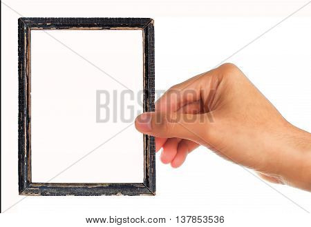 Picture of frame with human hand holding isolated on white background.