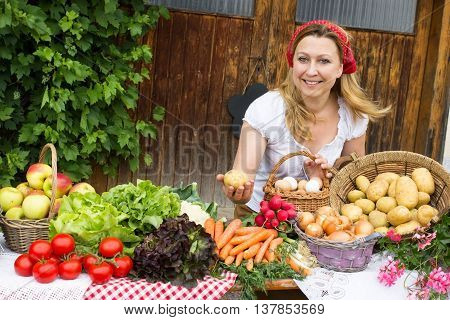 A peasant woman offers eggs at a market stall