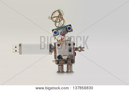 Robot with usb flash storage stick. Data storing concept, abstract computer character blue eyed head, electrical wire hairstyle. Copy space, gradient background