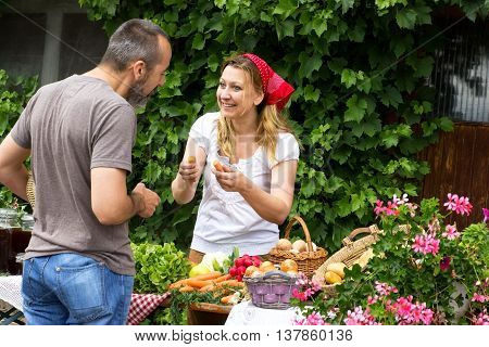 A man talking to a market woman