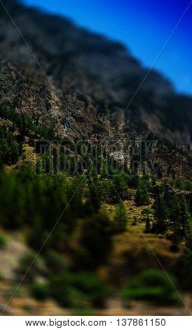 Vertical vivid summer toy mountain landscape bokeh background