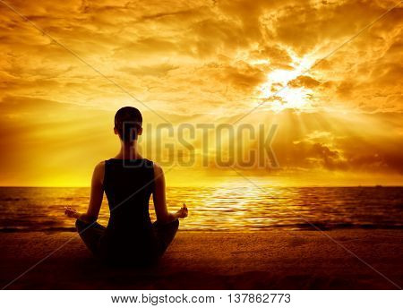Yoga Meditating Sunrise Woman Mindfulness Meditation on Beach Back View